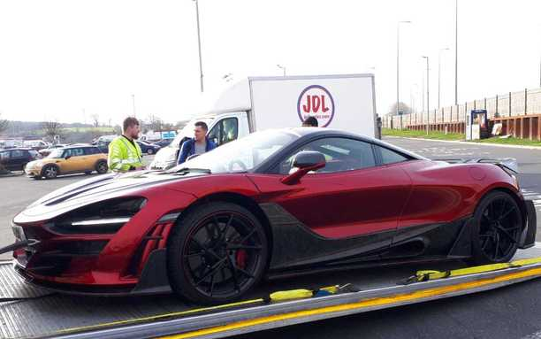 Sports car being collected for courier